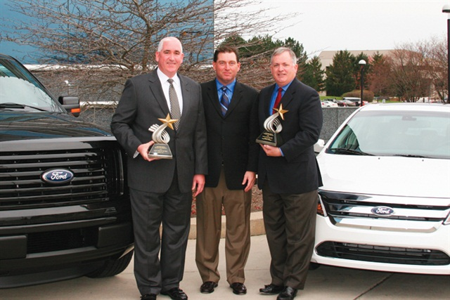 AF's Bob Brown (center), Great Lakes sales manager, presented the Fleet Car & Truck of the Year trophies to John Ruppert (left), general manager of Ford Commercial Sales, and Kevin Koswick, director of Ford North American Fleet, Lease and Remarketing Operations.
