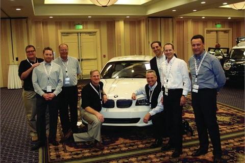 The BMW fleet sales team, along with members of the BMW international sales team, pose before the ActiveE, which was flown in from Munich for the fleet preview.