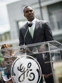 Clarence Nunn, president and CEO of GE Capital Fleet Services, addressed the crowd during the grand opening of the Vehicle Innovation Center.