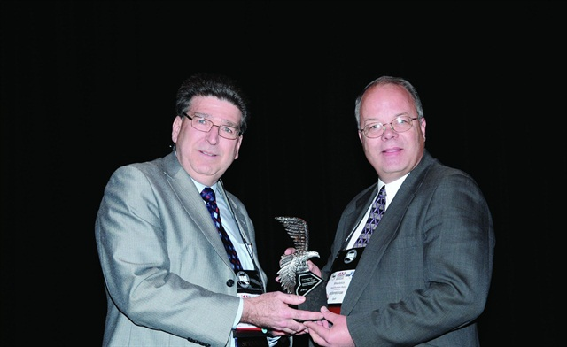 Automotive Fleet's Editor Mike Antich (right) gives Dan Kennedy (left) the award for the 2012 Consignor of the Year at the Conference of Automotive Remarketing.