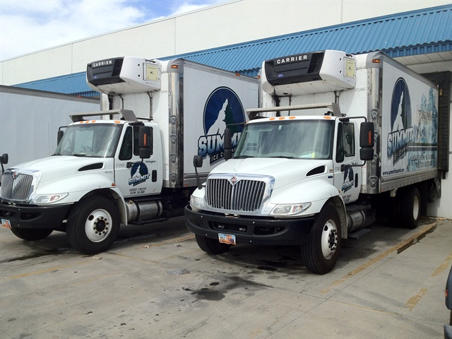 """Summit Ice, a Salt Lake City-based ice distribution company, leases almost all of its 15 vehicles through Penske and Ryder, including these 20-foot straight trucks from International. Summit Ice President Brian Washnock said he doesn't plan to start purchasing his own trucks as he likes the """"peace of mind"""" afforded by the truck leasing companies."""