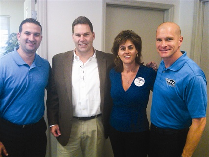 <p>Copart representatives pose for a group photo. (L-R) Yoker Vidal, regional account manager; Kevin Parker, VP of southern operations; Donna Stern, general manager; and Ben Bailey, regional account manager.</p>