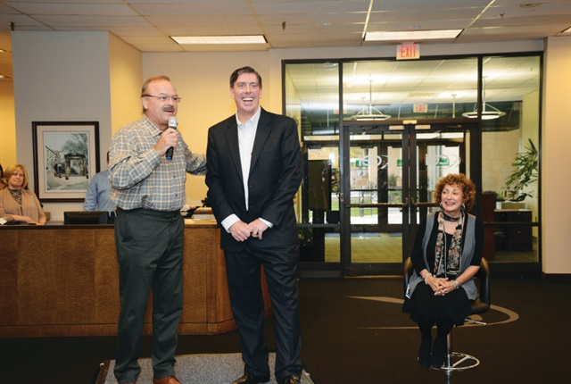 (L-R) Wayne Smolda, chairman of the board for The CEI Group, introduces John Wysseier as the new president & CEO, with Claudia Smolda, chief of staff. Photo: CEI