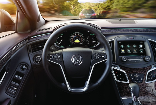 The instrument panel features an 8-inch-diagonal, reconfigurable driver information and cluster display; the center stack button count is down from 17 to seven.