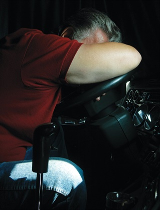 <p><strong>Grabbing a quick nap during a driving shift is a good way to restore alertness. Scheduling should allow drivers time to nap.</strong> <em>Photo Jim Park</em></p>