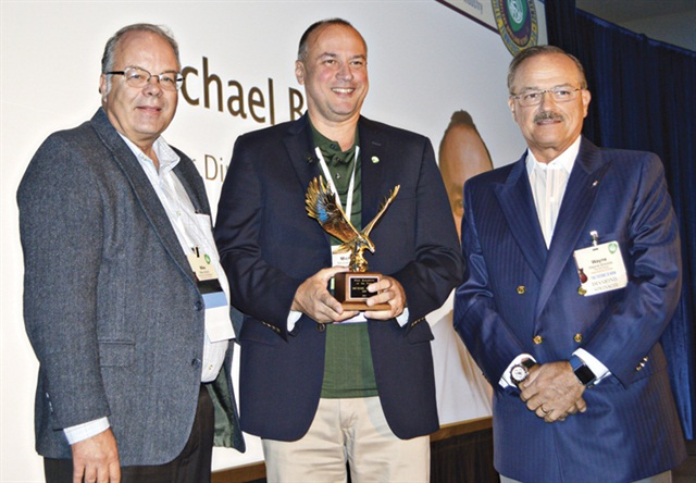 Michael Bieger (center) was presented his Fleet Executive of the Year award by Fleet Financials Editor and Associate Publisher Mike Antich (left) and CEI Founder and CEO Wayne Smolda at the annual Automotive Fleet & Leasing Association (AFLA) conference. Photo courtesy of Chris Wolski.