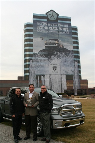 The Fleet Truck of the Year trophy was presented to Jim Sassorossi (left), Chrysler's director of fleet sales, and Pete Grady (right), VP of network development and fleet, by AF's Bob Brown, Great Lakes sales manager.