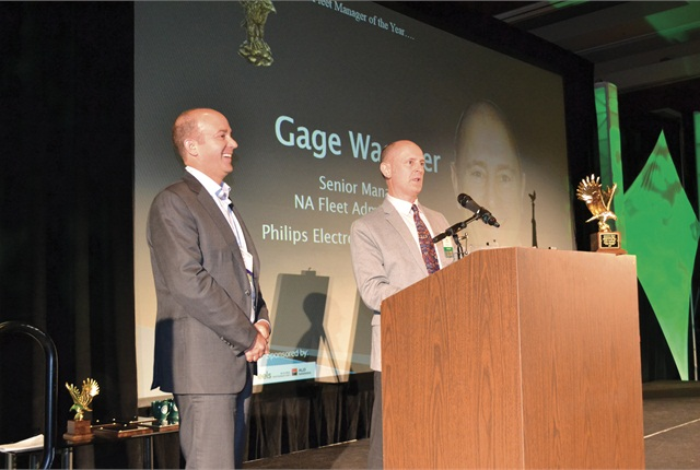 Gage Wagoner (right) accepts the award from Wheels Inc.'s Dan Frank. Photo by Chris Wolski.