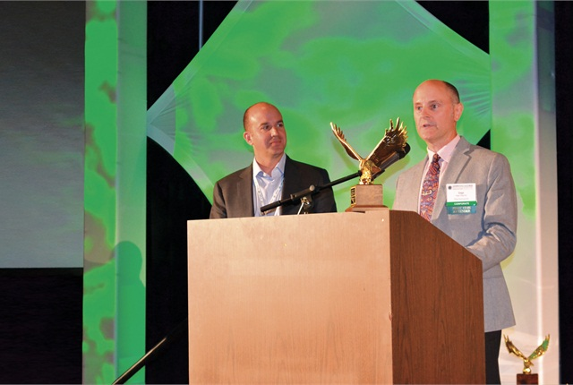 Dan Frank (left) presents the 2014 Professional Fleet Manager of the Year award to Gage Wagoner. Photo by Chris Wolski.