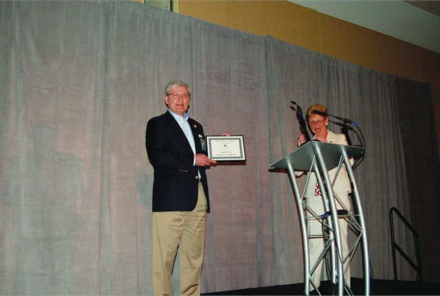 NETS Executive Director and Fleet Safety Conference keynoter Jack Hanley accepts the second-annual Fleet Safety Award on the behalf of Johnson & Johnson's Sandra Lee, from AALA President Pamela Sederholm.