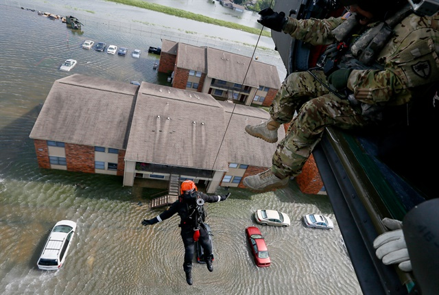 Photo of flooded vehicles in Houston by the Texas Air National Guard.