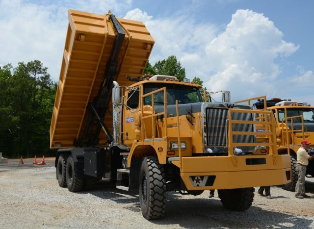 pstrongWestern Star's 6900XD in dump-box trim. Note the Palfinger hoist attached to the nose of the box./strong/p