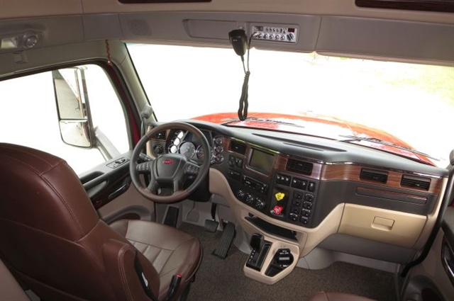 pstrongSimulated dark wood trim graces the dashboard and door panels, while dark brown leather covers the seats. Of course it has power windows and locks./strong/p
