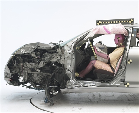 The dummy's position in relation to the door frame, steering wheel, and instrument panel after the new small overlap frontal test indicates that the driver's survival space was maintained reasonably well, according to the IIHS.
