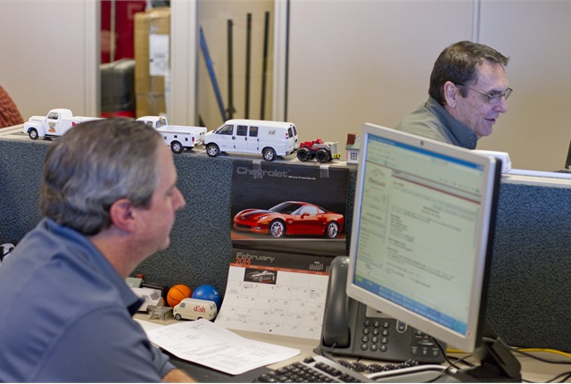 Dave Danner (left) and Jeff Dickinson keep tabs on DISH's nationally dispersed fleet through the use of telematics and other digital communications tools. Technology has been a means to help standardize the 4,700 vehicle fleet.
