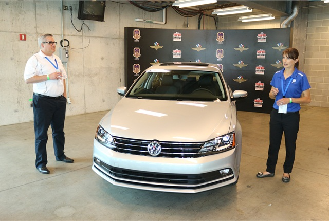 Martin Kiel and Tabitha Andretti go over the features of the 2015-MY Jetta. Photo courtesy of VW.