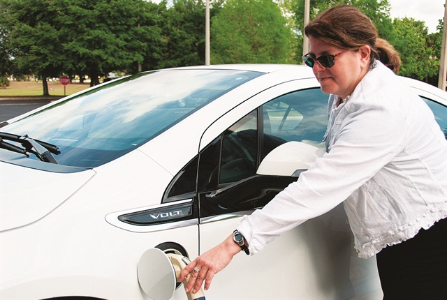 Linda Bluestein, co-director of the U.S. Department of Energy's Clean Cities program, plugs in a Chevrolet Volt rented through Drive Electric Orlando. Photo via Colleen Kettles, Central Florida Clean Cities Coalition