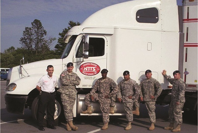 Soldiers from the Army's Fort Drum, N.Y., as well as Guard and Reserve troops, learn how to operate manual transmissions and other skills specific to civilian truck driving at the National Tractor Trailer School. Rick Catlin (in the white shirt) is a master instructor at the school.