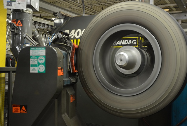 Retread plants grind off tread rubber so the new tread will fit properly around the casing. All the rubber removed in that process is lost miles-per-thirty-second to the fleet. Bridgestone suggests tires be run down to about 6/32 before retreading in order to get maximum safe mileage from the tread.