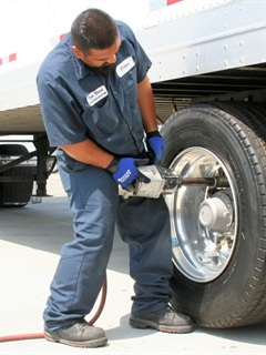 It's fine to run the nuts on using an impact wrench, but final fastener torque must be measured with a calibrated torque wrench.