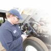 Shaun Groh from First Vehicle Services runs a maintenance check on an Eastman Chemical fleet vehicle.