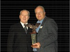 Bob Graham, ARI's vice president of Remarketing (left), receives the Consignor of the Year Award from AF Editor Mike Antich. Graham has 37 years of experience in remarketing. He has also served in leadership positions with the International Automotive Remarketers Alliance (IARA).