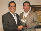 Bob Brown Jr., Great Lakes regional sales manager for Automotive Fleet (right), presents the 2014 Fleet Truck of the Year Award to Fritz Ahadi, general manager of commercial and government operations for Ford Motor Co.