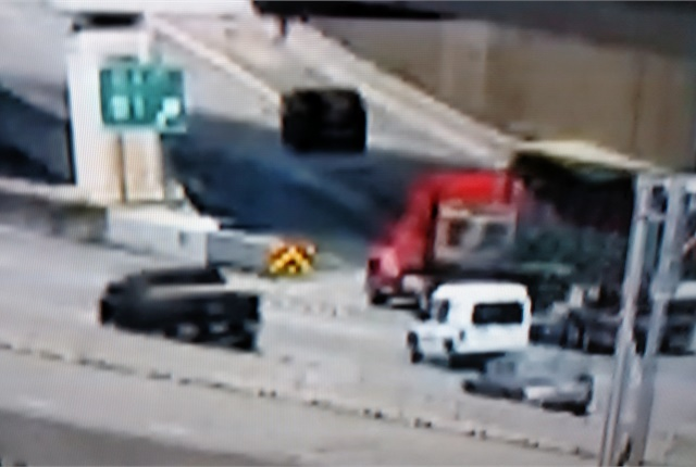 "<p><strong>Rig drifts out of its lane and heads toward a concrete barrier. Driver might have passed out from a ""medical emergency."" </strong><em>Images: Tom Berg, from TV newscasts</em></p>"