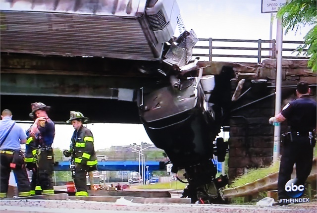 <p><strong>Strong coupling mechanisms supported the tractor and kept it from falling onto the street below. </strong><em>Photos: Tom Berg, from ABC World News Tonight</em></p>
