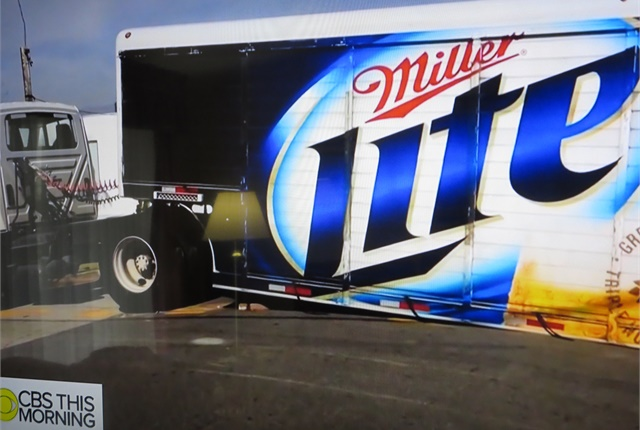 <p><strong>This low-slung beverage trailer barely scraped its way over the apex. Driver was probably using this route to bypass traffic backup on a more sane set of streets.</strong></p>
