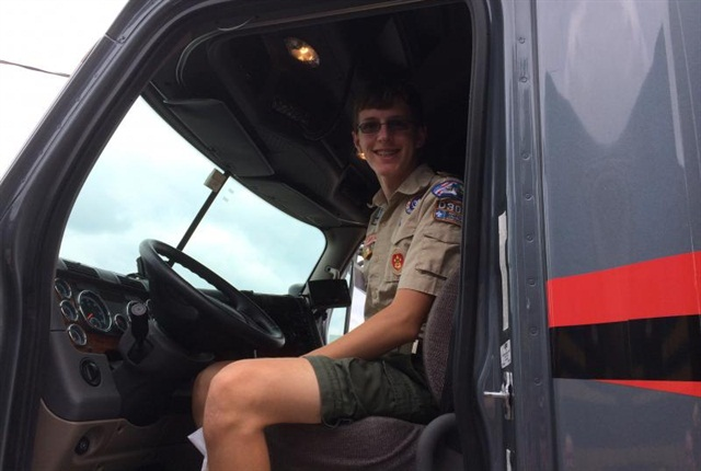 A Boy Scout checks out Jeff Clark's truck at the Walcott Trucker's Jamboree. Photo: Trucker Buddy