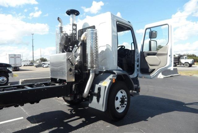 Peterbilt 220, built for street sweeping, has right-hand drive, while exhaust-aftreatment equipment is stacked close to the cab's rear to leave frame rails bare.