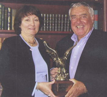 Ed presenting the 2003 AF Fleet Manager of the Year award to Josie Sharp, manager of fleet and safety for Aventis.