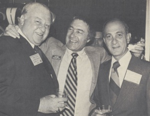 At a 1977 AALA convention, Ed (center) embraces Chevrolet's Chuck McCrary (left) and AFLA president Duke Tookman (right).