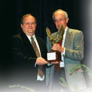 Jim Frank, Wheels Inc. CEO, (right) presents the Fleet Manager of the Year Trophy to 2008 winner Joe LaRosa.