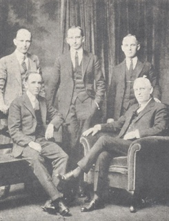 Founders of the Saunders system (seated , left to right) Ellis Saunders, Warwick Saunders (standing, left to right) Joe, Harris, and Warwick Saunders, Jr.