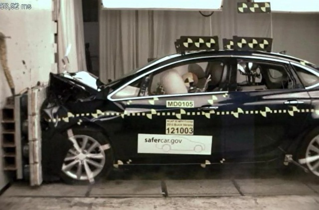 NHTSA crash-testing the 2013-MY Buick Verano.