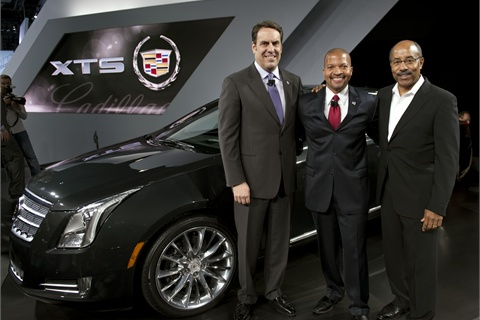 General Motors North America President Mark Reuss (l to r), Cadillac Marketing Vice President Don Butler and GM Vice President Global Design Ed Welburn at the introduction of the 2013 Cadillac XTS at the Los Angeles International Auto Show Wednesday, November 16, 2011 in Los Angeles, California. Photo by Steve Fecht for Cadillac.