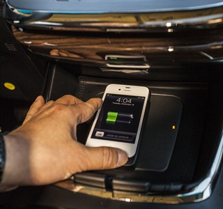 "The Qi wireless charging pad is located in the ""ebin"" in the 2013 Toyota Avalon."