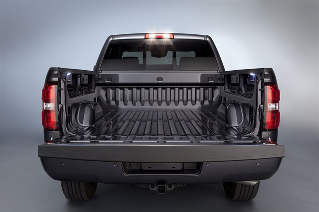 The all-new 2014 Sierra's bed features four standard upper tie downs and LED lights.