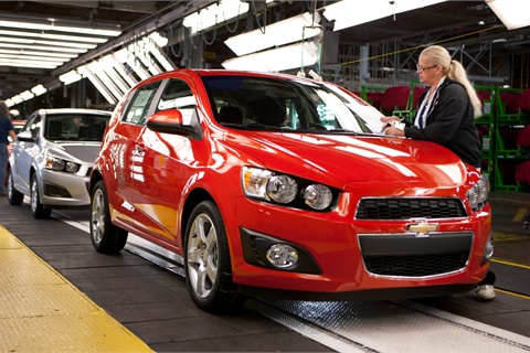 General Motors employee Peggy Burnside inspects a 2012 Chevrolet Sonic as it rolls off the assembly line at the GM Orion Assembly Plant Wednesday, September 14, 2011 in Lake Orion, Michigan.