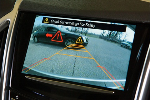 Cadillac Rear Cross Traffic Alert technology uses radar sensors that alert the driver of approaching cross traffic when backing out of a parking spot. Left or right-side vibrations in the driver's seat are triggered if vehicles are detected. (Photo by John F. Martin for Cadillac)