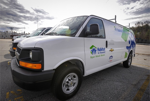 GM donated 24 Chevrolet Express vans to Habitat for Humanity. Photo courtesy GM.