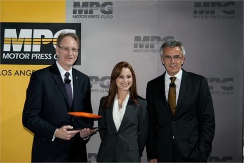 L to R: Johan de Nysschen, president of Audi North America; Laura Burstein, president of the Motor Press Guild; and Peter Schwarzenbauer, Audi board member for marketing.