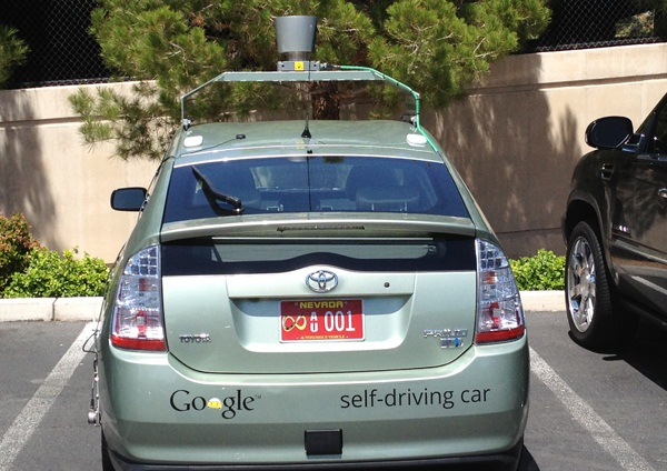 Google's autonomous vehicle license plate, issued by the Nevada DMV, is red with an infinity symbol on it.