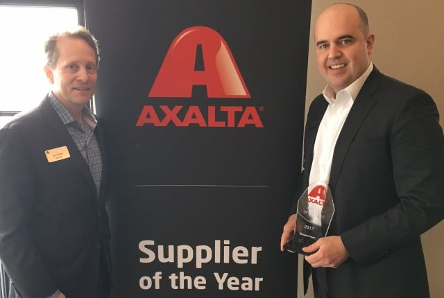 Photo of Parker (left) and Crnilovic accepting the award courtesy of