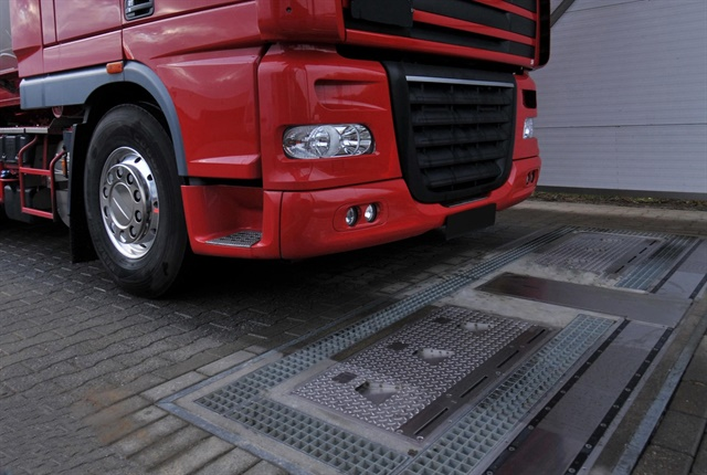 A truck prepares to drive over a fully-automated tire inspection system made by Ventech Systems GmbH. Photo courtesy of Goodyear.