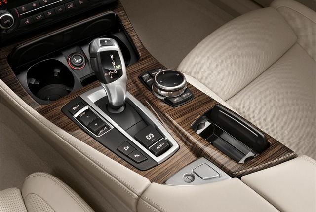 The iDrive control system features a new touchpad in addition to the traditional rotary controller. Photo courtesy BMW.