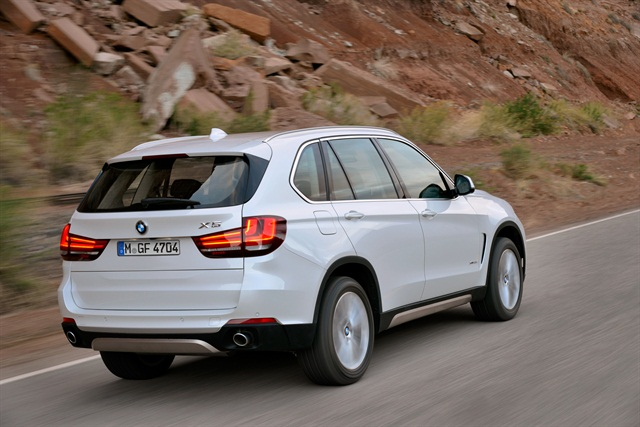 The top section of the rear tailgate can open and close via button or remote control now. Photo courtesy BMW.