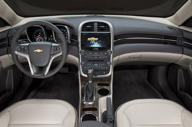 Inside, the automaker redesigned the Malibu's center console and added cupholders and space for two cell phones for 2014. Photo courtesy GM.